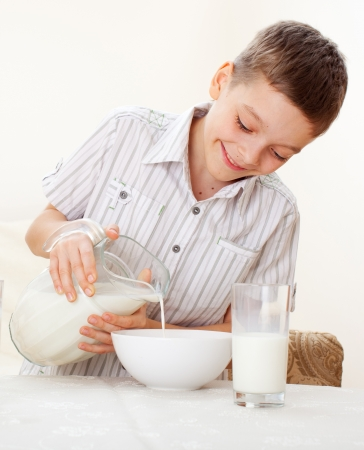 replenishment: Boy eat breakfast. Child eating cereals with milk