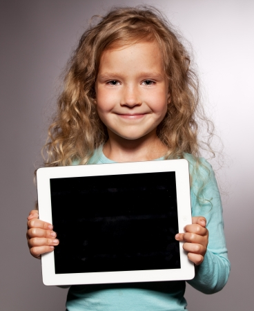 Happy child with tablet computer. Kid showing tablet screen