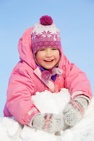 Child in winter. Happy girl on snow Stock Photo - 22427108