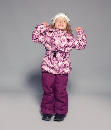 Children in winter clothes. Kids in down jackets. Fashion child photo