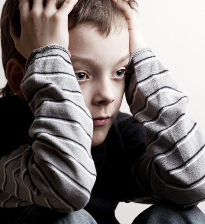 sad boy: Sad boy. Depressed teenager at home. Problems at family