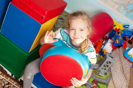 day care: Children in kindergarten. Kids in nursery school. Girl playing box of bricks at infant school