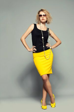 Fashion portrait woman in a yellow skirt photo