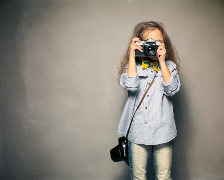 photographing: Child with camera. Little girl photographing