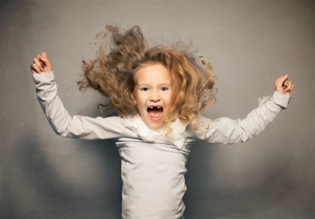 disobedient child: Screaming girl. Crazy child. Naughty, disobedient kid Stock Photo