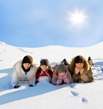 Family with children in the snow in winter.