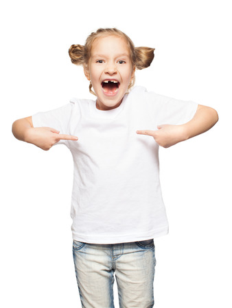 Child in white t-shirt. Girl isolated on white photo
