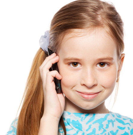Girl, speaking on the phone. Child talking on mobile phone isolated on white backgraund