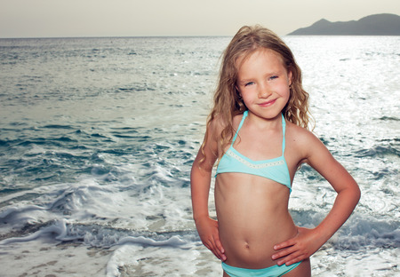 one little girl: Vacations  Girl on the beach  Sunset   Stock Photo