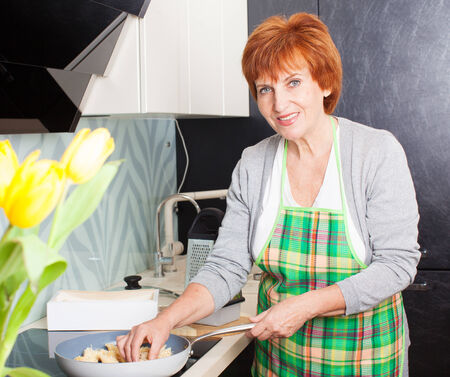 Female cooking at kitchen photo