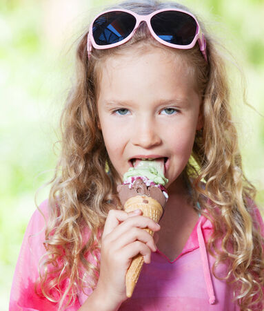 handcarves: Little girl with ice cream outdoors