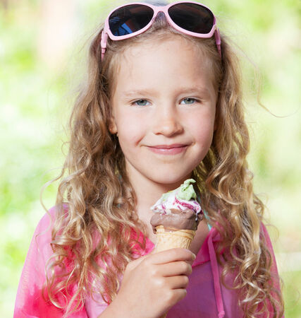 girl licking: Little girl with ice cream outdoors