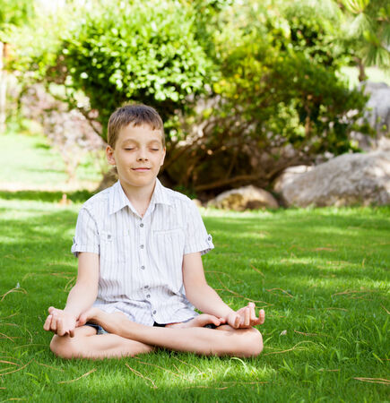 Boy engaged in yoga. Meditation photo