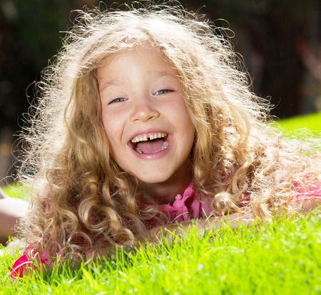 Girl at summer. Happy child outdoors photo