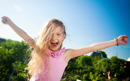 crazy girl: Happy girl at summer. Crazy child  Stock Photo