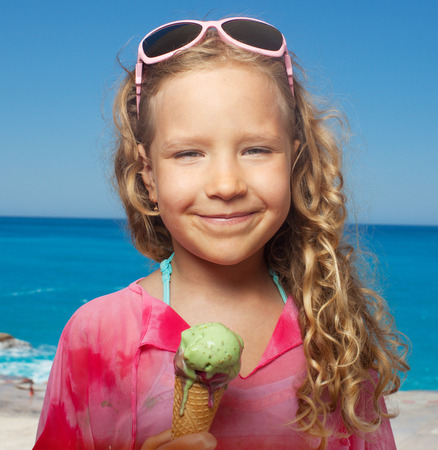 child ice cream: Child on the beach with ice cream. Girl at vacations on sea