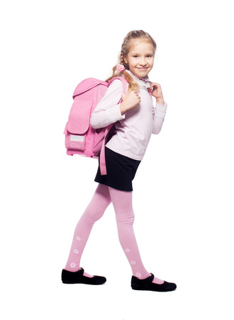 Child with schoolbag. Girl with school bag isolated on white photo