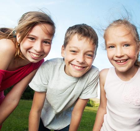 children only: Happy children outdoors. Friends at summer