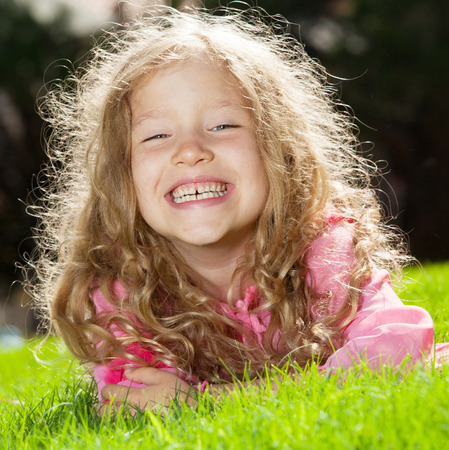 Girl at summer. Happy child outdoors