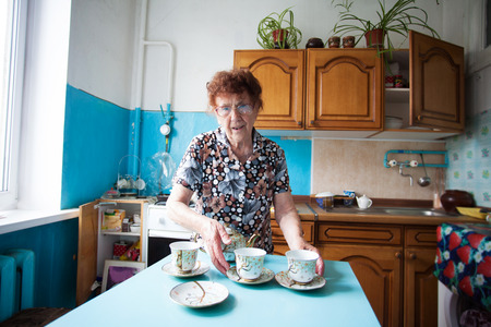 80 plus years: Elderly woman on the kitchen  Old woman at home Stock Photo