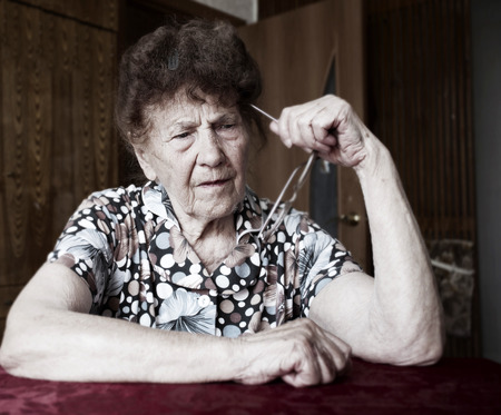 Old woman. Elderly female at home photo