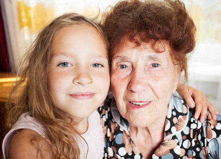 Senior with girl  Generation  Elderly woman with great-grandchild photo