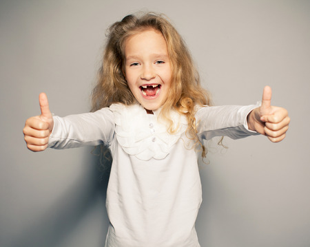 Happy little girl. Fun child showing ok Stock Photo - 30084517
