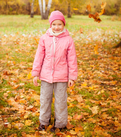 Girl at autumn. Little child outdoors Stock Photo - 30084536