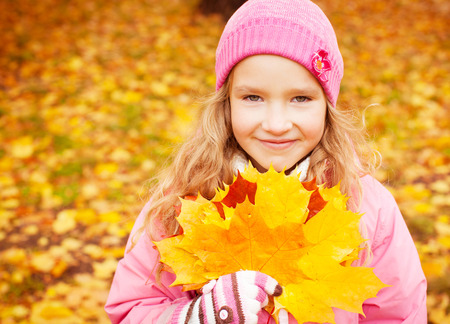 Girl at autumn. Little child outdoors Stock Photo - 30084537