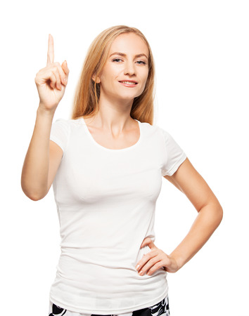 Woman at white background. Young female shows gesture Banque d'images
