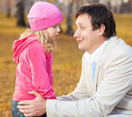 Dad pitying daughter. Sad child with father photo