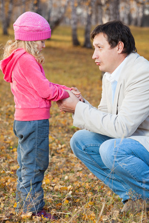 expressing negativity: Dad pitying daughter. Sad child with father Stock Photo