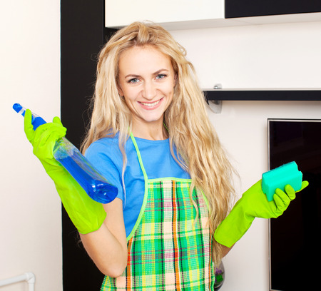 Woman cleaning house. Housewife at home photo