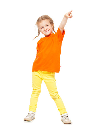 Little girl at yellow jeans. Child on white background photo
