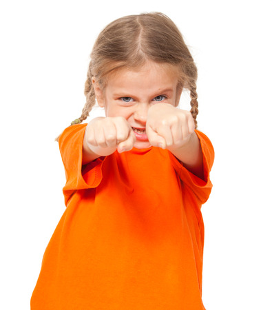 spoiled: Little angry girl. Child on white background