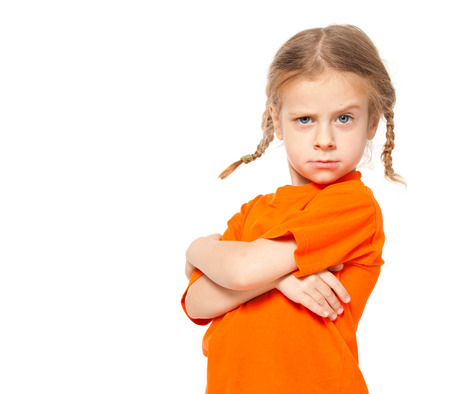 Little girl at yellow jeans. Child on white background Stock Photo