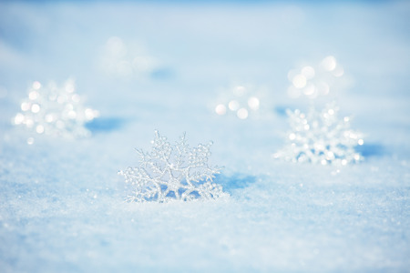 Winter background. Snowflakes on snow 스톡 콘텐츠