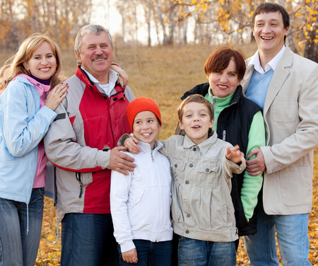 Families with children and grandparents in autumn park photo