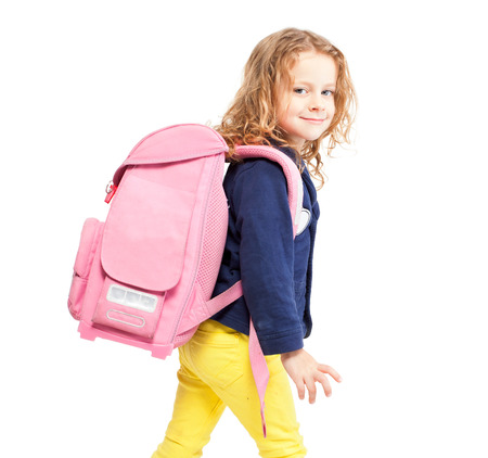 Little girl with schoolbag. Happy child on white Imagens - 31801126