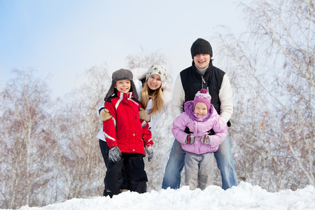 Happy family with children in winter park photo