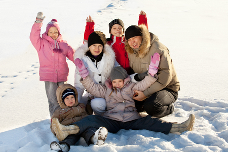 large family: Family with children in the snow in winter.