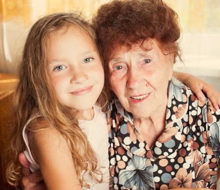 Senior with girl. Generation. Elderly woman with great-grandchild photo