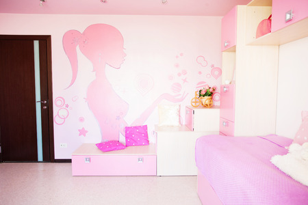 Interior of a child. Interior nursery for girl with a pattern on the wall. Nobody photo