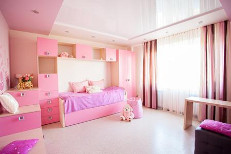 Interior of a child. Interior nursery for girl. Nobody 免版税图像