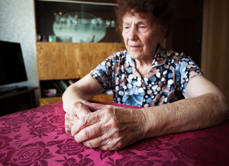 80 plus years: Old woman. Elderly sad female at home