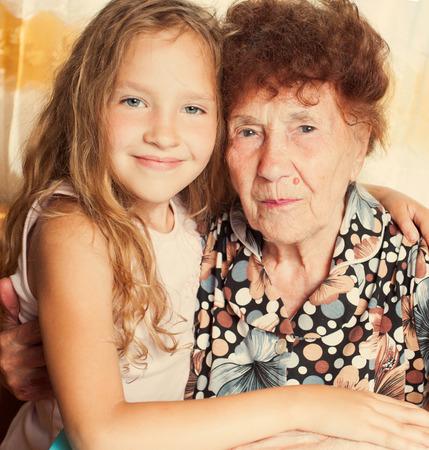 Elderly woman with great-grandchild photo