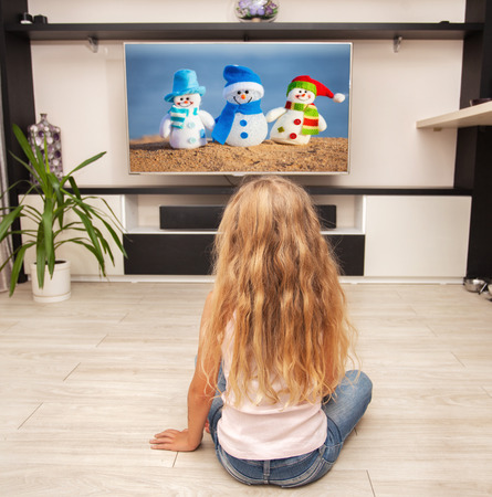hot girl lying: Child laying on the floor and watching TV at home