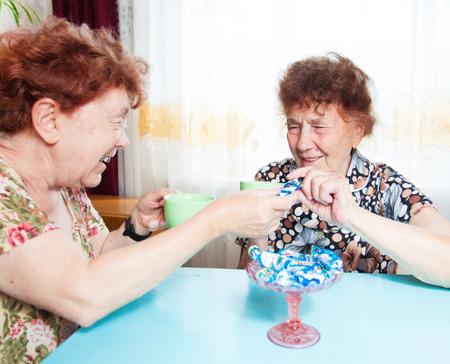 80 plus years: Two seniors drinks tea. Old woman talking. Friendship elderly