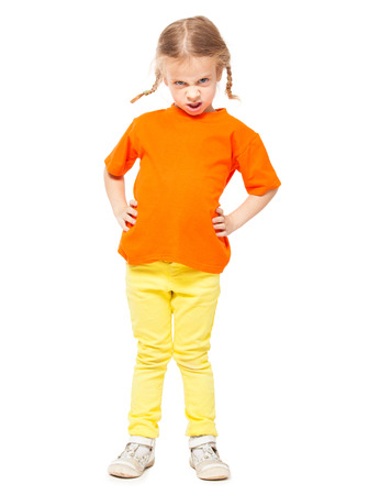 spoiled: Little spoiled girl at yellow jeans. Child on white background