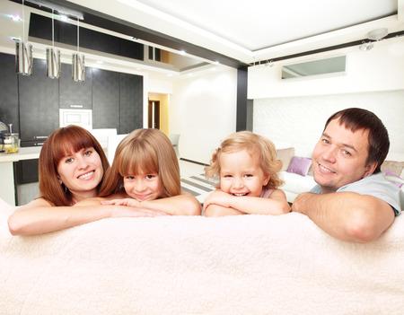 family sofa: Happy family with two children on sofa Stock Photo